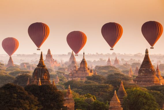 Hot-air-balloon-over-plain-of-Bagan-temple-complex-myanmar-buddhist-monuments